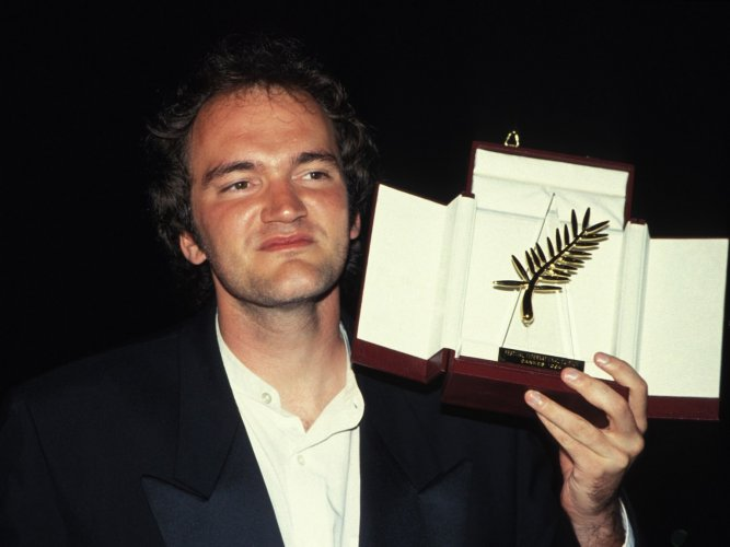 Quentin Tarantino with the Palme d'Or that he won for 'Pulp Fiction' in 1994.
