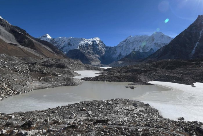 This picture taken on November 22, 2018 shows a general view of the Imja glacial lake controlled exit channel in the Everest region of the Solukhumbu district, some 140km northeast of Kathmandu. - Formed in the shadow of Mount Everest, the turquoise depth