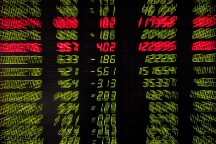 Stock prices are pictured on a screen at a securities company in Beijing on August 15, 2019. (Photo by AFP)