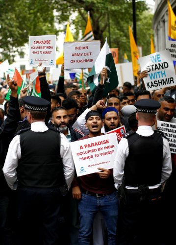 Demonstrators protest the scrapping of the special constitutional status in Kashmir by the Indian government, outside the Indian High Commission in London. (Photo by Reuters)