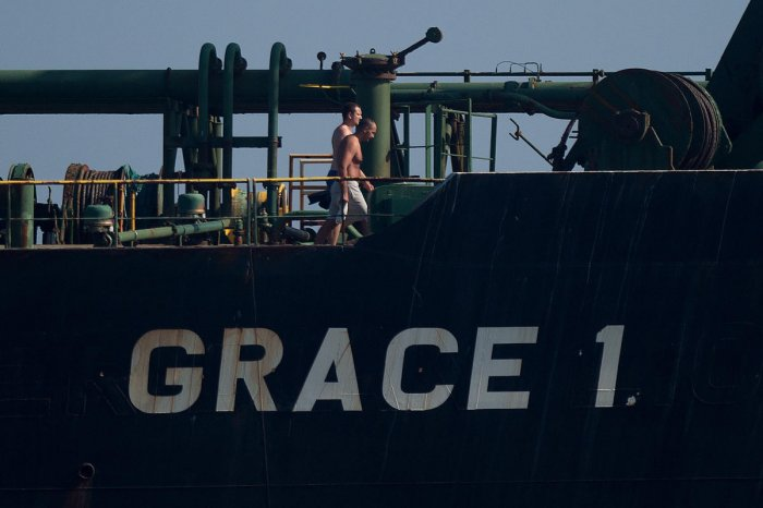 Crew members of Iranian supertanker Grace 1 walk on board off the coast of Gibraltar. AFP