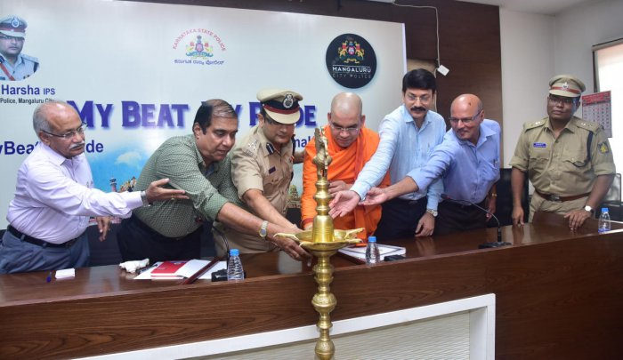 Retired DySP Sharief, Commissioner of Police Dr P S Harsha and Ramakrishna Mutt's Ekagamyananda inaugurate 'My Beat My Pride' in Mangaluru on Friday.