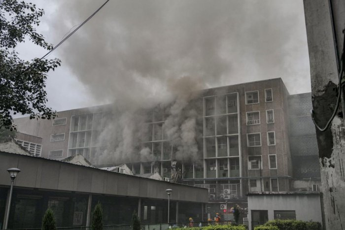 Smoke billows out as fire personnel douse fire which broke out at the teaching block of the All India Institute of Medical Sciences (AIIMS) in New Delhi, Saturday, Aug 17, 2019. (PTI Photo)