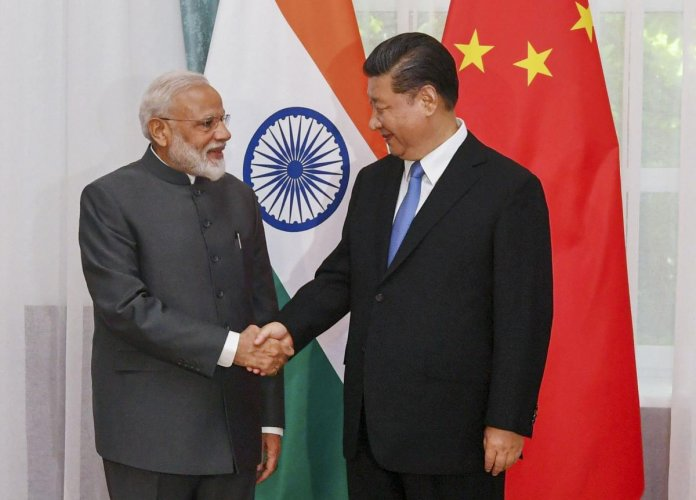 Prime Minister Narendra Modi shakes hands with Chinese President Xi Jinping on the sidelines of the Shanghai Cooperation Organisation (SCO) Summit in Bishkek, Kyrgyzstan, Thursday, June 13, 2019. (Twitter/PTI Photo)