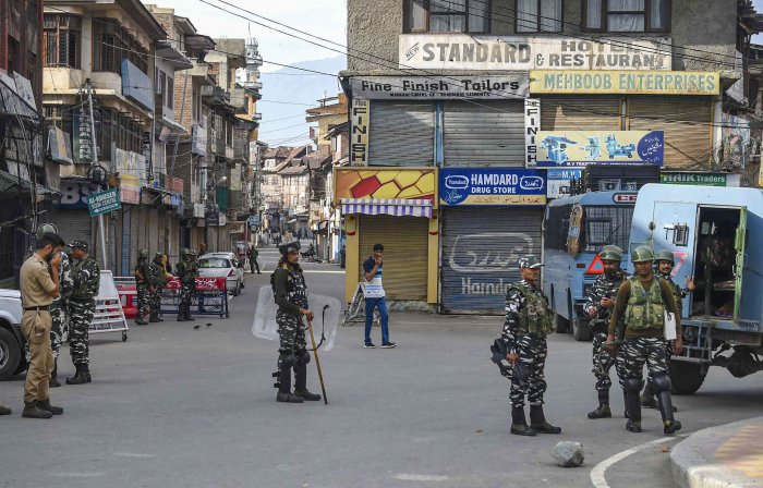 Security personnel stand guard during restrictions following the abrogation of the provisions of Article 370, in Srinagar. (PTI Photo)