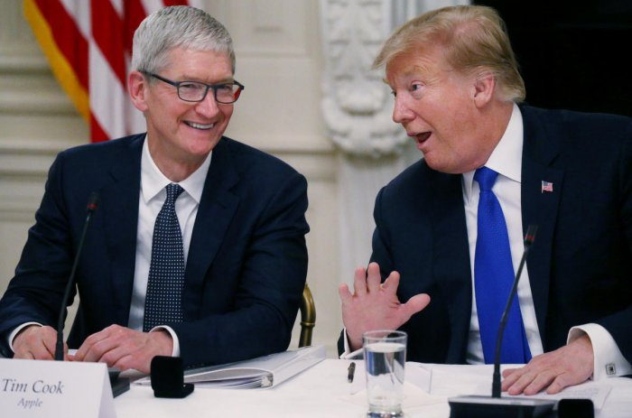 Apple CEO Tim Cook with U.S. President Donald Trump. (Reuters file photo)