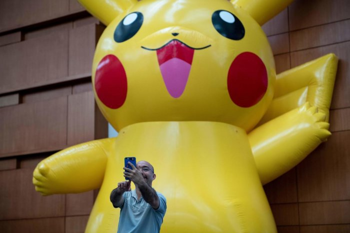 A man takes a selfie with a Pikachu during the first day of the 2019 Pokemon World Championships. (AFP file photo)