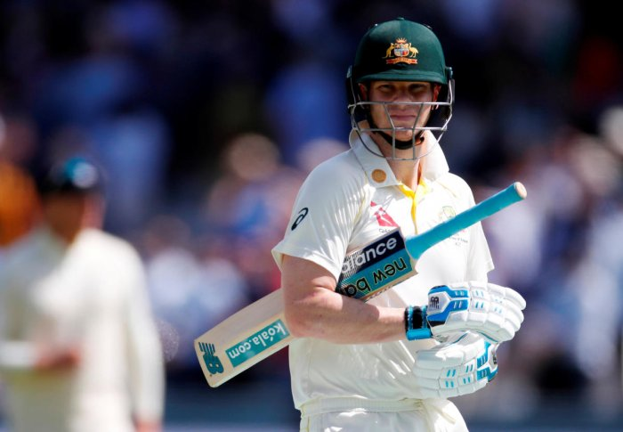 Smith, who made 144 and 142 in Australia's emphatic victory in the first test, moved on to 53 not out with Tim Paine unbeaten on 21 and the touring side trailed by 103 runs in the rain-affected match. (Reuters photo)