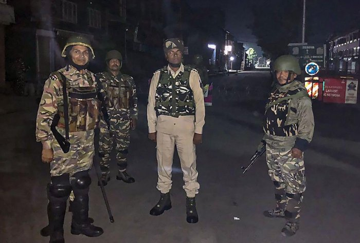 Srinagar: CRPF jawans stand guard in downtown Srinagar, Saturday-Sunday intervening night, Aug 17, 2019. (PTI Photo/Sumir Kaul)