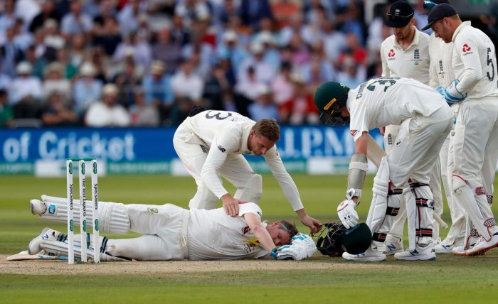 Australia's Steve Smith lays on the pitch after being hit in the head by a ball off the bowling of England's Jofra Archer. (AFP photo)