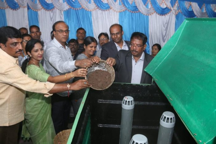 Mayor Gangambike Mallikarjun, BBMP Commissioner N Manjunath Prasad and others at a composter installed at the civic body's head office on Saturday.