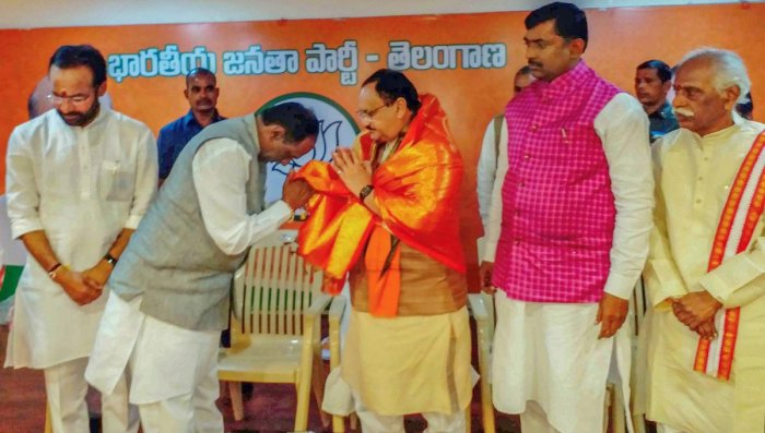 BJP Working President JP Nadda greets office bearers at BJP office in Hyderabad on Sunday. PTI