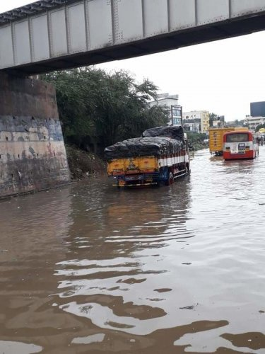 Movement of vehicles was affected as rainwater accumulated under Chandapura railway bridge following heavy rain late on Saturday night. DH Photo