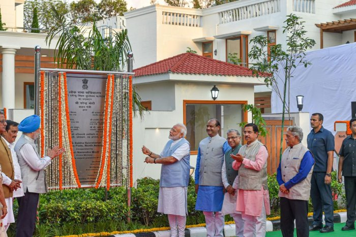 Prime Minister Narendra Modi inaugurates Lok Sabha Secretariat duplex flats in North Avenue in the presence of Lok Sabha speaker Om Birla, Housing & Urban Affairs Minister Hardeep Singh Puri and others in New Delhi on Monday. PTI