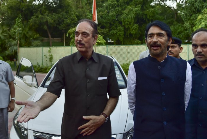 Senior Congress leader Ghulam Nabi Azad arrives at his residence, in New Delhi. Azad was stopped at the Srinagar airport and sent back by a flight. (PTI Photo)