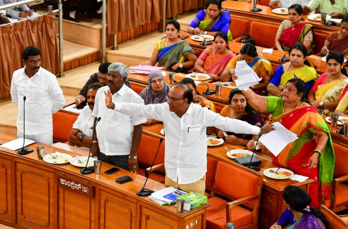 Ruling party leader Abdul Wajid and former mayor G Padmavathi respond to the Opposition's charges in the BBMP council on Monday. (DH PHOTOS/KRISHNAKUMAR P S)