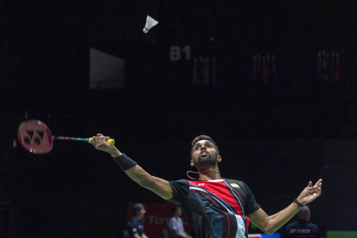 India's H.S. Prannoy returns a shuttlecock to China's Lin Dan during their men's singles second-round match at the BWF Badminton World Championships in the St. Jakobshalle in Basel, Switzerland. (PTI Photo)