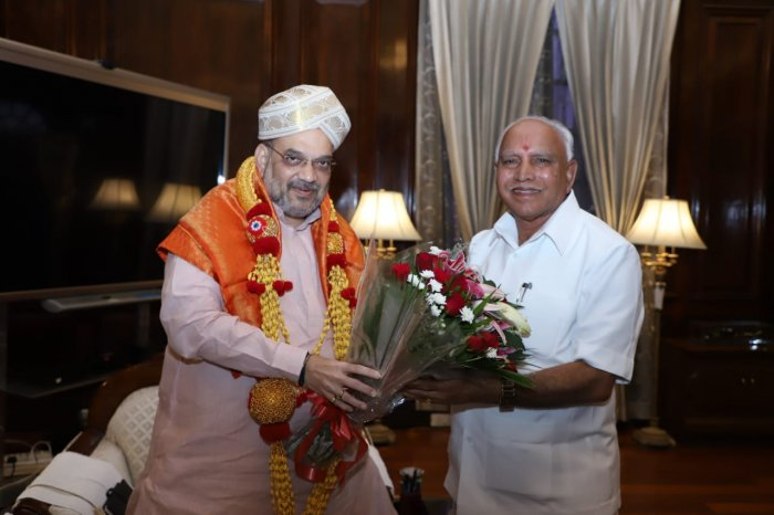 Amit Shah has left nobody in doubt as to who the real boss is. Yediyurappa has been told to adopt the 'Gujarat model', in which a cluster of departments will be monitored by an IAS officer from the chief minister's secretariat. (DH File Photo)