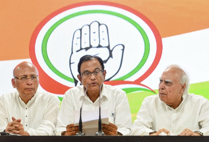 Congress leader P Chidambaram addressing a press conference with party leaders Kapil Sibal and Abhishek Singhvi at AICC HQ, in New Delhi, Wednesday, Aug 21, 2019. The Delhi High Court on Tuesday refused to grant any protection from arrest to Chidambaram in the INX media case. (PTI Photo)