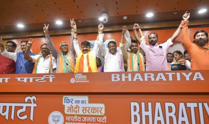 BJP leaders Kailash Vijaivargiya and Mukul Roy join hands with two Trinamool Congress and one CPM legislator, who joined Bharatiya Janata Party. (PTI Photo)