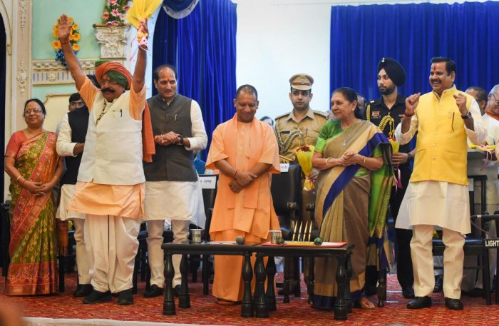 Uttar Pradesh Governor Anandiben Patel and Chief Minister Yogi Adityanath with the newly inducted ministers Uday Bhan Singh (hands raised), Suresh Rana and Mahendra Singh after their swearing-in ceremony at Raj Bhawan in Lucknow, Wednesday, Aug 21, 2019.