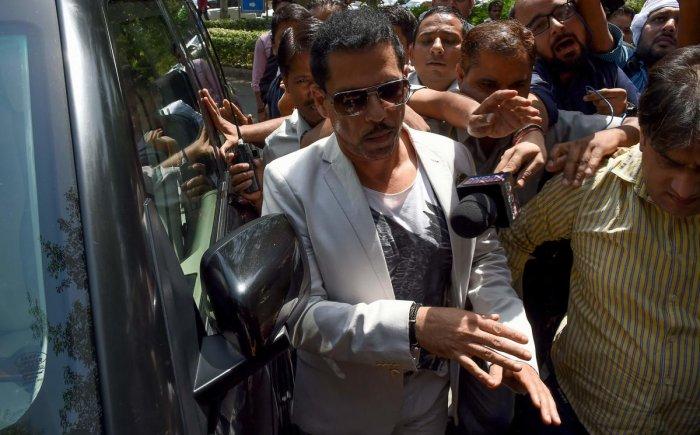 Robert Vadra (C), Indian businessman and husband of Indian politician Priyanka Gandhi (unseen). (AFP Photo)