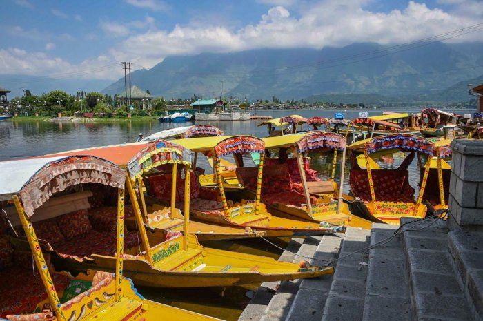 Shikaras lay abandoned at a ghat as restrictions continue in the Valley, at Dal Lake in Srinagar, on August 18, 2019. PTI