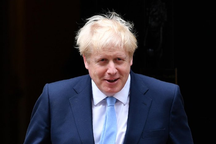 On his first foreign visit since taking office, Johnson will seek to convince German Chancellor Angela Merkel, and French President Emmanuel Macron, to renegotiate elements of the Brexit. (AFP file photo)