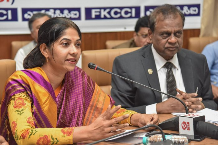 Shikha C, Managing Director, BESCOM, speaks at an interactive meeting organised by the Federation of Karnataka Chambers of Commerce and Industry (FKCCI) in Bengaluru on Tuesday. DH PHOTO/S K Dinesh