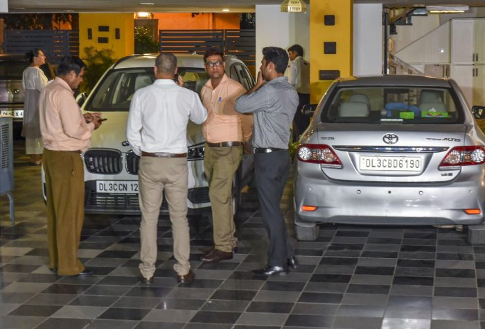 Enforcement Directorate (ED) officials inside the residence of Congress leader P. Chidambaram during a raid, in Jorbagh, New Delhi. (PTI Photo)
