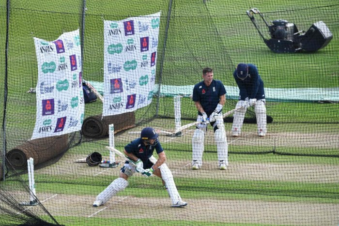 England's Jos Buttler (L) bats in the nets during a practice session at Headingley Stadium in Leeds, northern England. (AFP Photo)