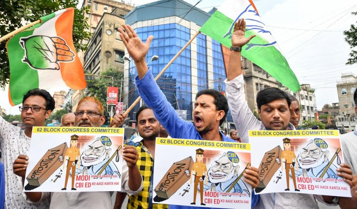 Congress workers shout slogans during a protest against the arrest of the party leader P Chidambaram, in Kolkata, Thursday, August 22, 2019. (PTI Photo)