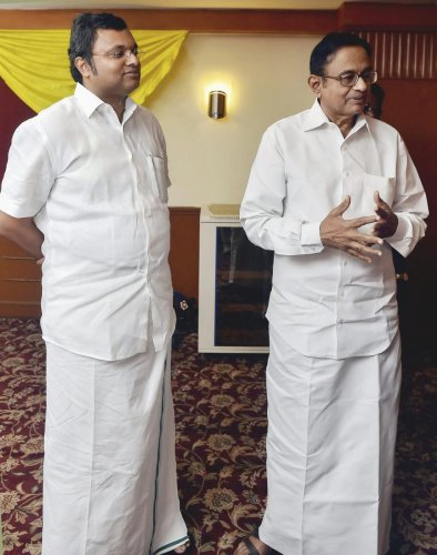 P Chidambaram (right) with his son Karti P Chidambaram. PTI file photo