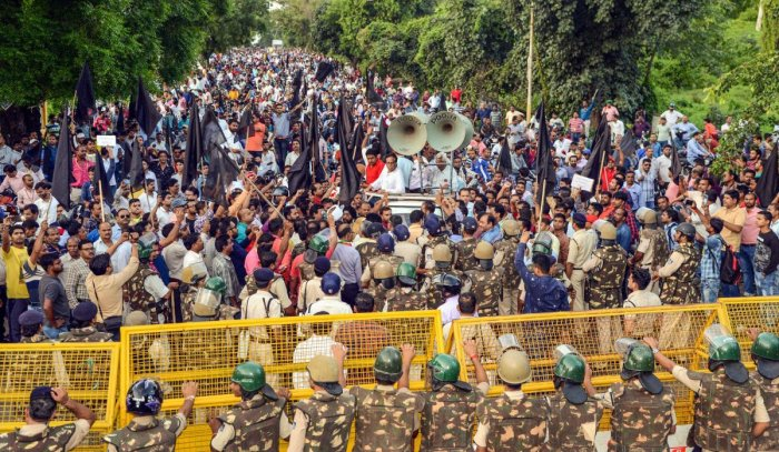 All India employees take part in a protest rally against the Central government over the proposed privatization of 41 ordnance factories in Jabalpur. (PTI Photo)