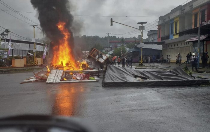 Fires burn during a violent protest in Manokwari, Papua province, Indonesia. (AP/PTI Photo)