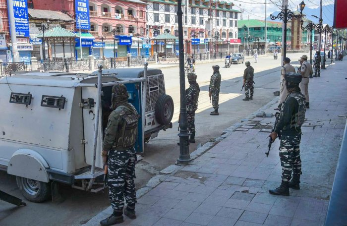 CRPF personnel stand guard at Lal Chowk after restrictions were lifted, in Srinagar. (PTI Photo)