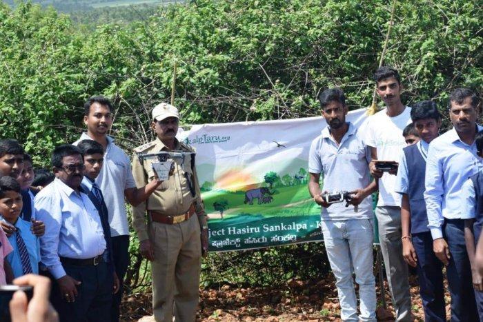 Sankalpataru Parisara Samrakshana Samsthe took up aerial seeding at Malledevaramatti hilly areas in Hoovinahalli in Birur.