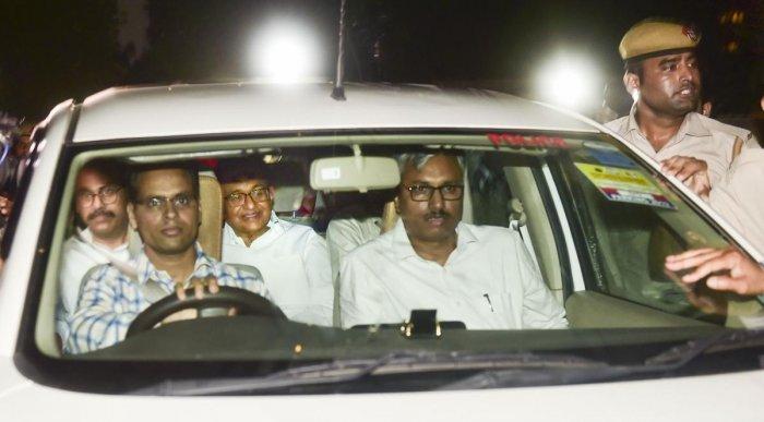 Central Bureau of Investigation (CBI) officials arrest Congress leader P Chidambaram from his Jor Bagh residence in New Delhi. (PTI Photo)