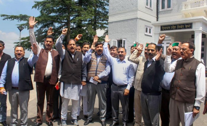 Congress leader Mukesh Agnihotri and other party leaders protest in support of former union minister P Chidambaram, against his arrest by CBI in the INX media case, outside Vidhan Sabha in Shimla. PTI photo