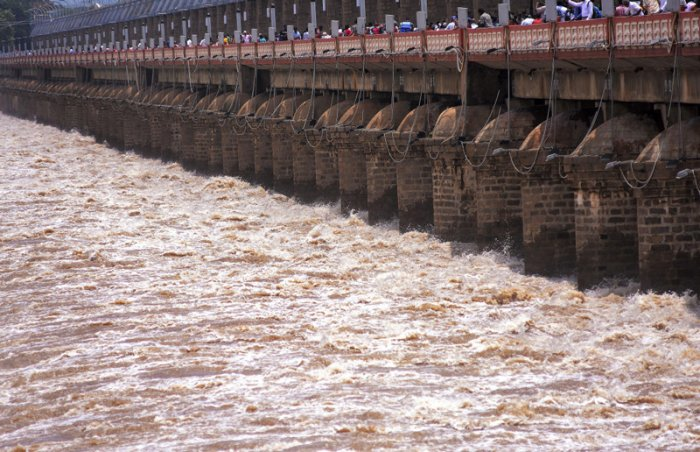 Water gushes out as all the gates of Prakasam Barrage across the Krishna river have been opened due to heavy inflow following monsoon rains, in Vijayawada. (PTI Photo)