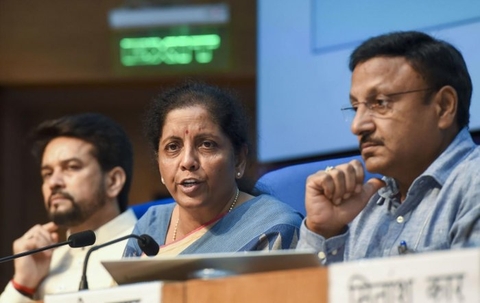Finance Minister Nirmala Sitharaman, MoS for Finance Anurag Thakur, and finance secretary Rajiv Kumar during a press conference in New Delhi on Friday. PTI photo