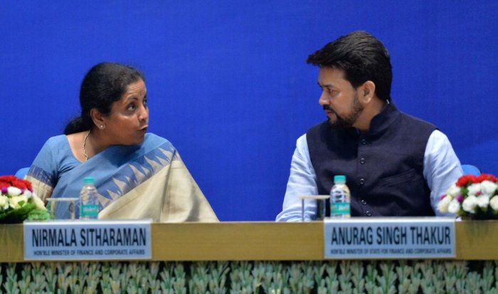 Finance Minister Nirmala Sitharaman and MoS for Finance Anurag Thakur during a function to celebrate 'Ten Years of Competition Law Enforcement' at DRDO Bhawan, in New Delhi on Friday. PTI photo