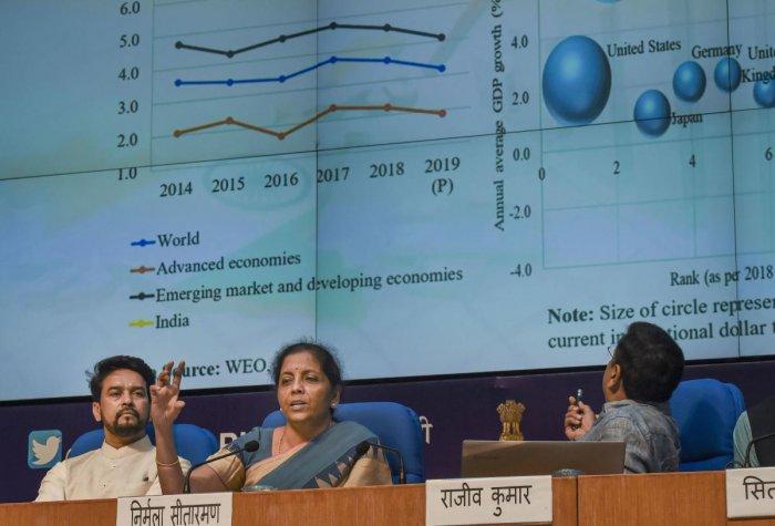 Finance Minister Nirmala Sitharaman, MoS for Finance Anurag Thakur, and finance secretary Rajiv Kumar during a press conference in New Delhi on Friday. PTI photo