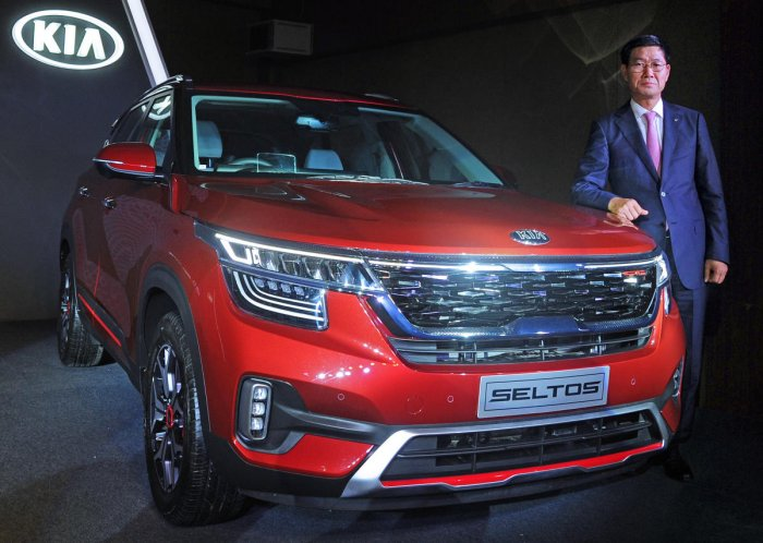 KIA Motors India CEO and managing director Kookhyun Shim poses with the Seltos SUV during the car's launch in Bengaluru on Friday. DH photo