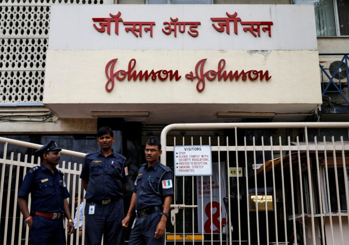 Security guards stand outside the office of Johnson & Johnson in Mumbai, India. (Reuters Photo)