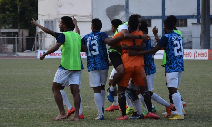 THRILLED: Services players celebrate after defeating Karnataka in the semifinal in Ludhiana on Friday. AIFF