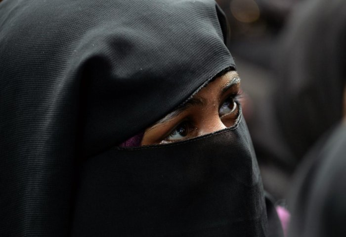 """India's parliament passed on July 30 a law against the controversial Muslim practice of """"instant divorce"""", making it a criminal offence punishable by up to three years in prison. (Photo by AFP)"""