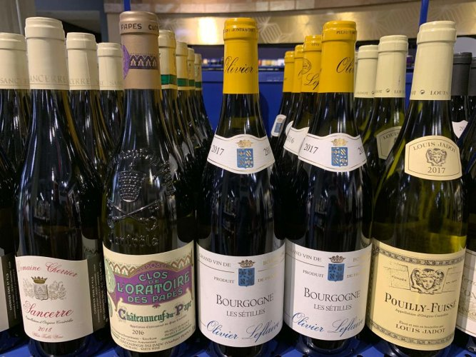 French wines are dislpayed for sale at a supermarket in Los Angeles, California on August 18, 2019. - President Donald Trump has floated the idea of a tariff of as much as 100% on French wine while speaking at a recent fundraiser, in response to the French tax on US tech firms. AFP