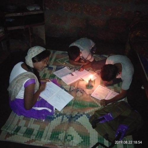 Children study using a kerosene lamp, at a house in Thathkola in Chikkamagaluru district.