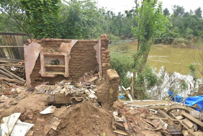 This collapsed house on the river bank at Karadikodu in Virajpet taluk of Kodagu districtis a tell-tale sign of disaster. A study by EMPRI shows that encroachment and construction activities in the 300-meter buffer zone on either side of the river pose a